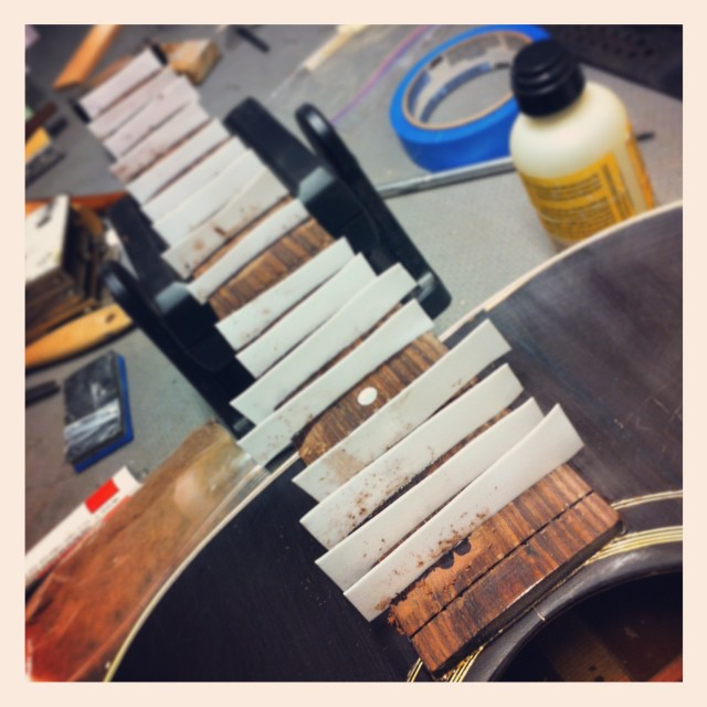 Heavy work on this 91 Gibson J45. A weekend luthier had replaced the frets with big awkward jumbos and tore up the fretboard in the process.  time to fix the board and refret... #gibson #guitar #guitarrepair #luthier #luthierslife #whatsonyourbench