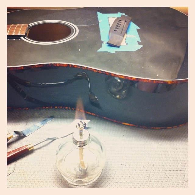 Decided to go a little old timey with this bridge removal.  Worked like a charm. #luthier #luthierslife #guitartech #guitarrepair #whatsonyourbench